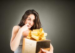 Eager to open a gift - stock photo