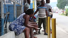 Cuban Refugees Sitting and Waiting for Documentation.  Stock Footage