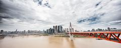 Cityscape and skyline downtown near bridge of chongqing in cloud sky Stock Photos