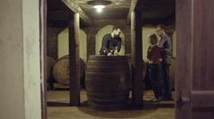 Senior couple entering a wine cellar Stock Footage