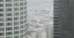 Tilt down from view through skyscrapers to Downtown Los Angeles streets 4K Stock Footage