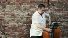 Musician playing the contrabass. Stock Footage