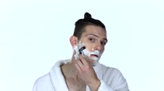 Man shaves stubble with razor blade. White background. Slow motion Stock Footage