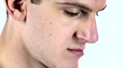 Man put on area of cheek shaving cream. White background Stock Footage