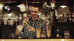 Attractive Bartender making a cocktail at the bar Stock Footage