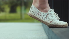 CU Young Caucasian female stands on tiptoe in vintage footwear Stock Footage