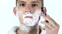 Man shaves cheek using razor blades. White background. Slow motion Stock Footage