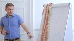 Teacher holds seminar in white workshop for beginners in design - stock footage