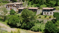 A number of old houses in the town of Rupit, Catalonia. A popular tourist Stock Footage