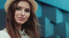 Portrait of a young beautiful Caucasian female wearing vintage straw hat - stock footage
