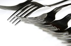 Forks arranged in series on the kitchen table Stock Photos