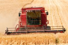Combine harvester in action Stock Photos