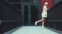 Portrait of a young female walking in a vintage dress, wearing a straw hat Stock Footage