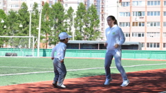 Happy mother and son at the stadium, enjoying their sports activity. healthy Stock Footage