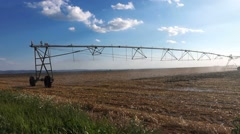 Center pivot irrigation system with drop sprinklers in field Stock Footage