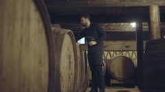 Farmer pouring wine from barrel Stock Footage