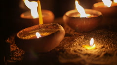 Asian candles in religious ceremony , dolly right shot - stock footage