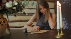 Woman write a letter using antique pen Stock Footage