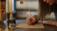 Woman write a letter using ink pen - cropped frame Stock Footage