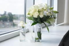 Beautiful wedding bouquet in a glass vase - stock photo