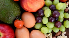 Healthy Diet with fresh fruit, apples, pears, avocados, grapes, eggs, nuts, t Arkistovideo