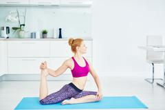 Yoga in the kitchen - stock photo