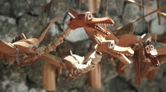 Wooden dragons toys on strings close up - street seller Stock Footage