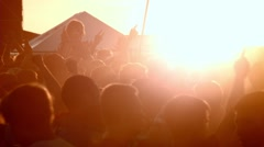 Crowd of fans on music festival. Sunset Stock Footage