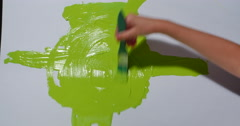 Child Painting Lime Green on White Paper Background 422 10bit, 4K Stock Footage