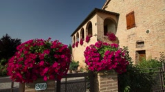 Typical Tuscan country house with flowery garden Stock Footage