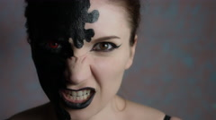 4k Shot of a Woman with Halloween Make-up Making Evil Face Stock Footage