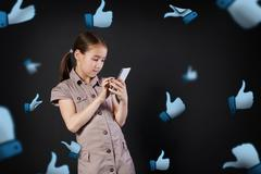 Children addiction to social networks. Little girl engrossed on mobile Stock Photos