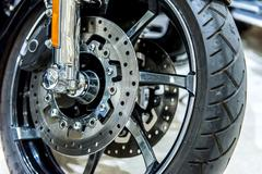close up of motorbike brake in wheel - stock photo