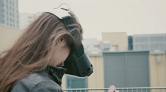 Brunette woman girl with waving hair uses a virtual reality glasses on the roof Stock Footage