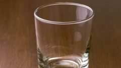 Tasty orange breakfast drink splashing into drinking glass, slow motion Stock Footage