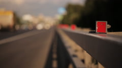 Movement of cars on highway in Sunny day. Roadside in area of focus. Stock Footage
