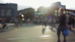 Unfocused figures of pedestrians walking through city street Stock Footage