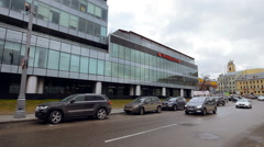 View of Cars Parked Outside Glass Office Building. Road, Cars Go, Parking, Stock Footage