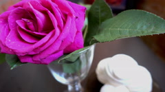 Little cakes and rose on wooden table on Valentine's Day. Love the concept of Stock Footage