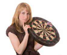 The girl holds target with arrows of a darts Stock Photos