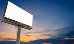 Blank billboard ready for new advertisement with sunset background - stock photo