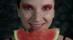 4k Shot of a Woman with Multicoloured Make-up Eating a Watermelon Stock Footage
