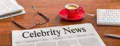 A newspaper on a wooden desk - Celebrity News Stock Illustration