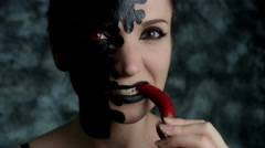 4k Shot of a Woman with Halloween Make-up Eating Hot Chilli Pepper  - stock footage