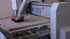 Woodworking CNC mechanism. Wooden doors production automated line - stock footage