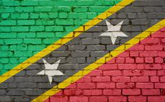 Brick wall with painted flag of St Kitts and Nevis Stock Photos