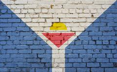 flag of Saint-Martin painted on brick wall - stock photo