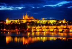 skyline of Prague with Vitus cathedral and Charles bridge - stock photo