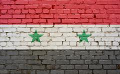 Flag of Syria painted on brick wall, background texture Stock Photos