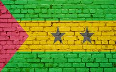 Flag of Sao Tome and Principe painted on brick wall, background texture Stock Photos